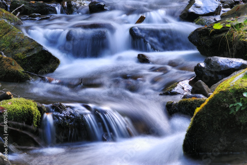 autumn waterfall. Picturesque creek in the Carpathian Mountains - 185407504