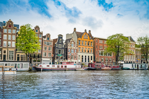 Fotobehang Amsterdam Amsterdam, the Netherlands, September 5, 2017 :typical dutch houses and houseboats. Amsterdam, Holland, Netherlands
