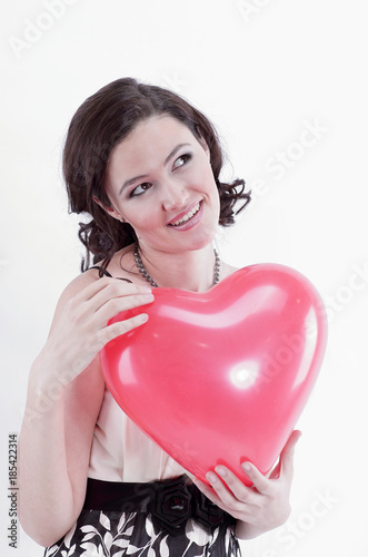 beautiful young woman holding red balloon heart. Poster