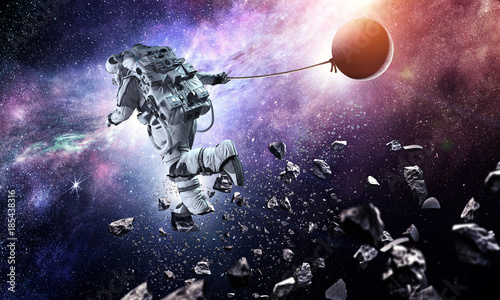 fantasy-image-with-spaceman-catch-planet-mixed-media