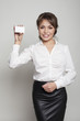 Business woman on white bg holding white visit card