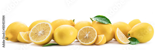 Lot of lemon fruits with lemon leaves isolated. Horizontal photo. - 185453984