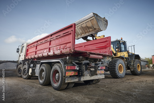 Excavator moving sand and gravel  - 185456170