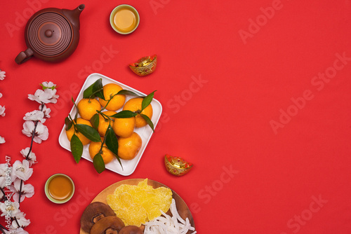 Conceptual flat lay Chinese New Year food and drink still life.