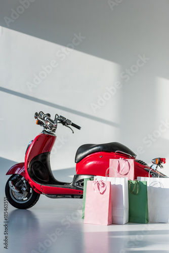 Foto op Canvas Scooter red vintage scooter and arranged shopping bags