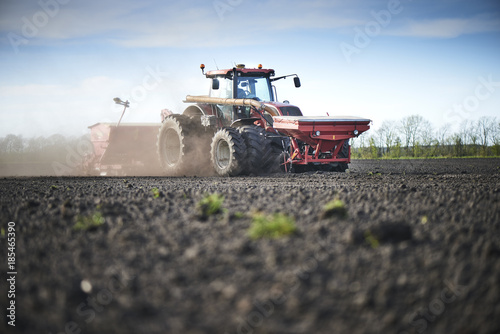 Red tractor plow field