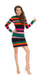 Smiling Fashion Model In Colorful Mini Dress And High Heels Is Showing Thumb Up