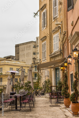 Corfu, Greece- December 21, 2017: Narrow streets and alleys in Corfu town Greece.Architecture in the old town of Corfu is heavily influenced my the Venetian architecture.