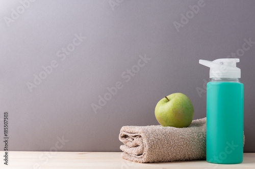 Fotobehang Spa Towel and water bottle with apple