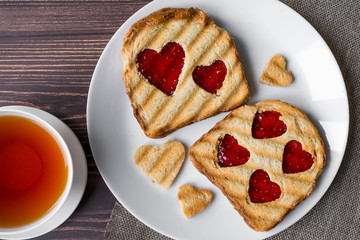 Grilled toast with raspberry jam and tea