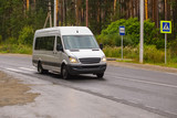 minibus goes on the country highway - 185516926