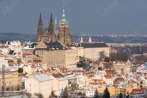 Prague castle and snowy roofs of Mala Strana from Seminarska Garden in Prague, C Poster