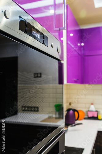 kitchen appliances built into kitchen cabinets. Production of furniture production. The utensils and items for the kitchen. focus numbers on the display