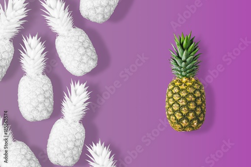 White colored pineapples on a vivid pink background. Minimal concept. - 185565574