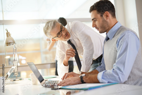 Financial people working together on budget in office