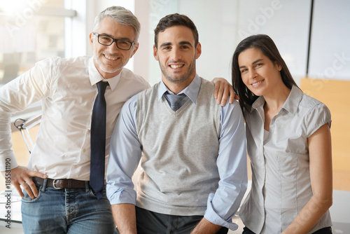 Portrait of start-up team standing in office