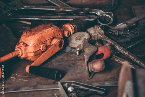 Foto Murales Vintage tools on a worn workbench
