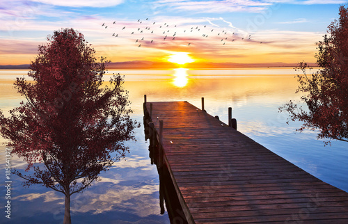 Foto Murales puesta de sol en el lago del parque natural