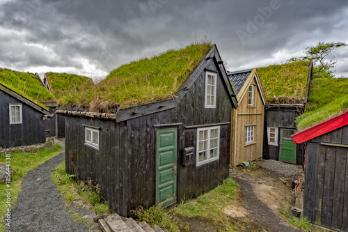 Deurstickers Grijs Far oer island wood grass roof house