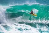 Surfer riding big green wave at Padang Padang beach, Bali, Indonesia - 185663785