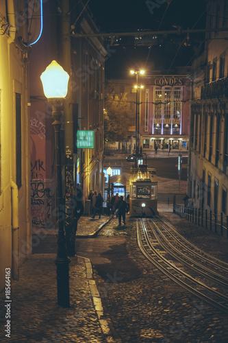 Poster Smal steegje Lisbon at night - Street scene of Lisbon, tram, city life, city lights - Portugal
