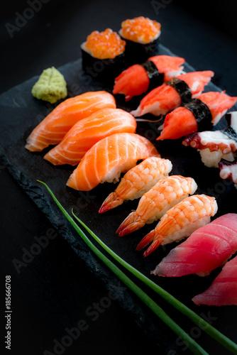 Foto op Canvas Sushi bar Set of Sushi & Sasimi on black stone plate