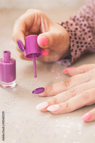 Foto op Canvas Manicure Manicure with purple nail polish. Macro, selective focus, copy space
