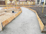 Building new concrete pavement foundation in the garden. Foundation for paving, path, walkway. - 185686565