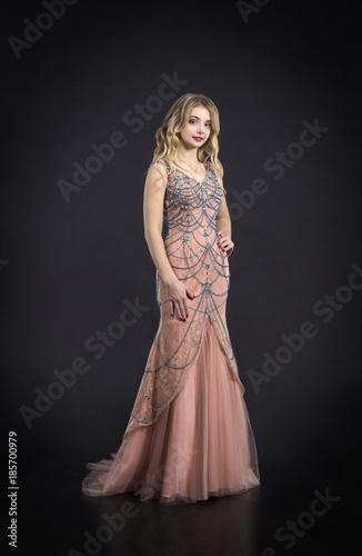 Deurstickers Kapsalon Beautiful woman in gorgeous dress.