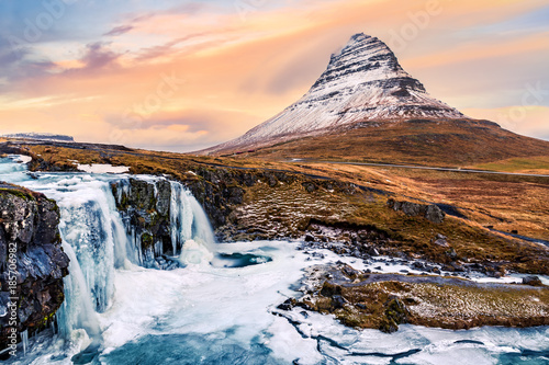 Kirkjufell mount and waterfall. Kirkjufell (Church mountain) is a 463m high mountain on the north coast of Saefellsnes peninsula and a famous icelandic landmark - 185706982