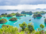 Wonderful island shape with forest, clear turquoise sea or lagoon, speedboats and cloudy day. - 185723912