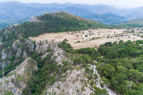 Fotobehang Blauwe hemel Aerial view of the plateau in the mountains of Bosnia and Herzegovina, the village of Klobuk.