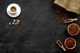 Coffee concept. Roasted beans, ground coffee, cup of espresso and sugar on black background top view copyspace - 185745915