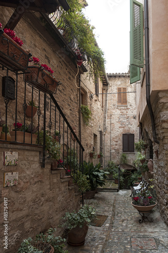 Keuken foto achterwand Smal steegje Spectacular traditional italian medieval alley in the historic center of beautiful little town of Spello (Perugia), in Umbria region - central Italy