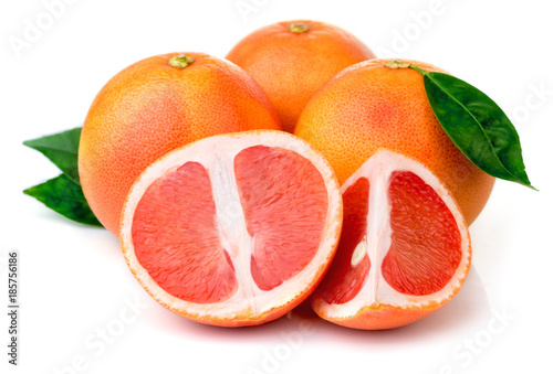 Pink grapefruits with green leaves isolated on white background