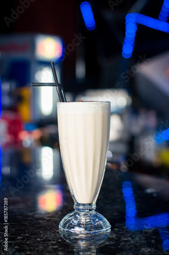 Tuinposter Milkshake Three glasses of various milkshakes (chocolate, strawberry and vanilla) isolated on white background