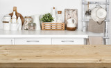 Fototapety Brown wooden texture table over blurred image of kitchen bench