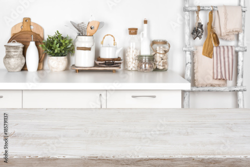 Empty wooden texture table with blurred image of kitchen interior
