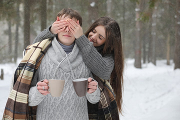 pair of lovers on a date winter afternoon in a snow blizzard