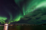 Amazing Aurora Borealis in North Norway above the sea, Tromso City