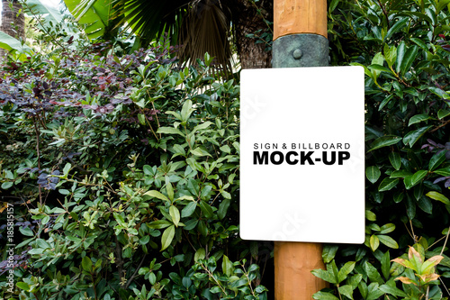 Fotobehang Amusementspark The mock up blank white screen banner on wooden pole