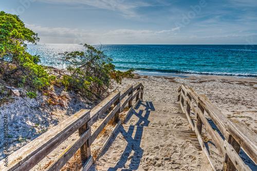 Foto Murales Wooden boardwalk on the sand in Alghero