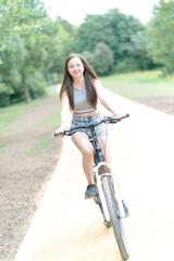 Girl teenager on a bicycle