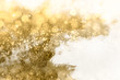 Abstract golden background. Sparkling and twinkling bokeh