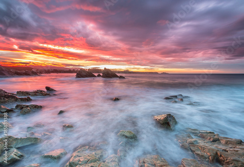 Aluminium Strand spectacular and colorful sunset on the beach of Arnao