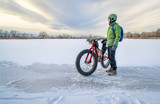 senior cyclist is riding a fat bike in winter - 185845146