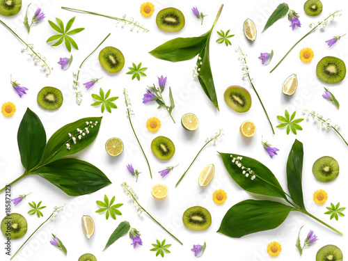 Fotobehang Lelietjes van dalen Composition pattern from plants, kiwi, lily of the valley isolated on white background, flat lay, top view. The concept of summer, spring, Mother's Day, March 8.