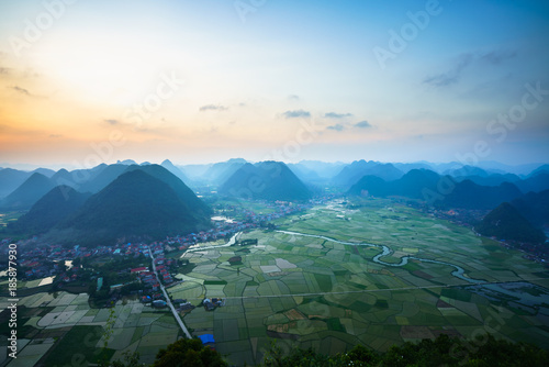 Fotobehang Blauwe jeans Vietnam sunrise landscape with rice field and mountain in Bac Son valley in Vietnam