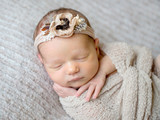 Newborn baby girl swaddled in wrap - 185881323