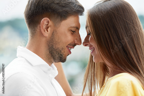 Young Couple In Love Enjoying Each Other Outdoors.